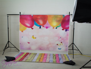 Pink Balloons and coloured timber vinyl background