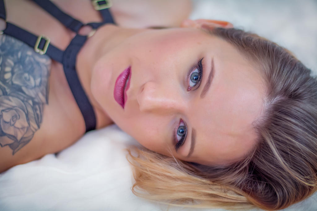 beautiful woman lying down portrait with cairns photographer Catherine coomnbs